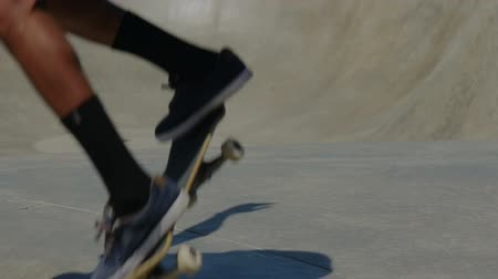 deskorolka : slowmotion of skateboarder at skatepark