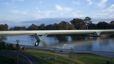 mavi gök : 4K Time lapse of Adelaide Elder Park, River Torrens and pedestrian bridge