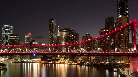 mosty : BRISBANE, QLD, AUSTRALIA - July 27, 2015: 4K Time lapse Story Bridge at sunset twilight in red light illumination during Blood Donor Week in Brisbane
