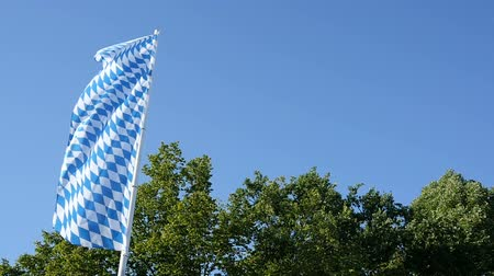bavarian flag : Bavarian flag moving in slow motion in the wind with a blue sunny sky