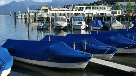 cover : Boats at the Jetty tied up and covered with water reflections and the mirror image of the ship in the lake Stock Footage