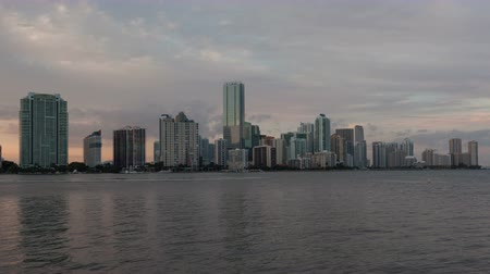 sunset light : 4K Timelapse Miami city skyline panorama at dusk with urban skyscrapers extended version