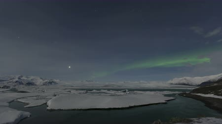northern nature : 4K Time lapse of Northern Lights Aurora Borealis dancing over the Glacier lagoon Jkulsarlon in Iceland.