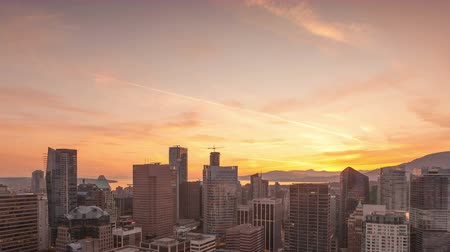 sunset sea : VANCOUVER, BC, CANADA - MAY 28, 2015: 4K Time lapse close up aerial city view of Vancouver sky above the skyline at sunset