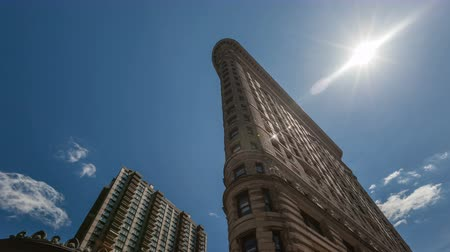flatiron building : NEW YORK CITY, USA - MAR 02, 2015: 4K Timelapse close up historic Flatiron Building in Manahattan with the sun shining