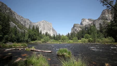prado : Yosemite Valley Merced river and El Capitan, the Cathedral Rocks and the Bridalveil Falls with a blue sky in the background