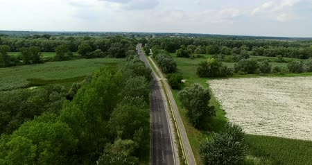 railwayman : Aerial drone shot country side with road