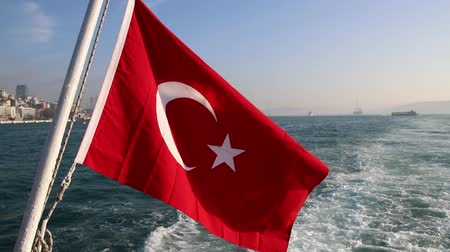 mesquita : Turkish flag waving on the stern of an Istanbul Ship is Floating