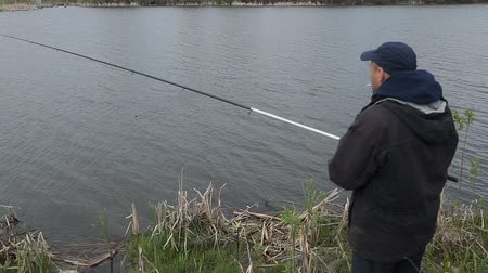 ботинок : fishman on the lake with a fishing rod