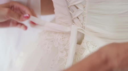 espartilho : Hand knotted wedding dress Stock Footage