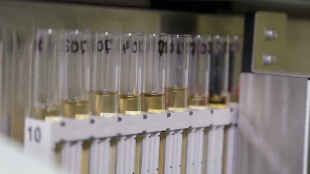 ellenőrzés : Laboratory machine for analysis of urinalysis. Test tubes close-up.