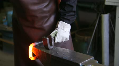 oppression : blacksmith, forges, piece, red-hot, metal., close-up. Stock Footage