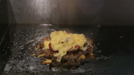Burger pattu wish sausages, onions, mushrooms and cheese are roasted on the stove