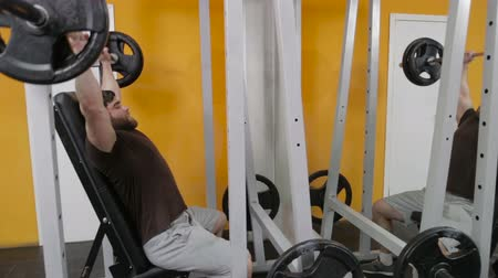 powerlifter : powerlifter raises the bar sitting