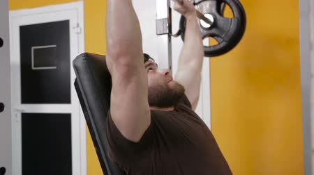 raises : strongman raises the bar sitting