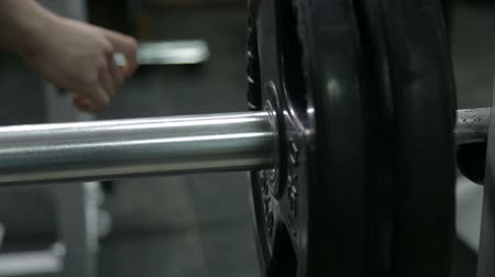 powerlifter : powerlifter bodybuilder puts weight on the bar of the bar