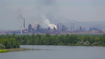 capacidade : metallurgical and oil plants. City landscape beyond the river.