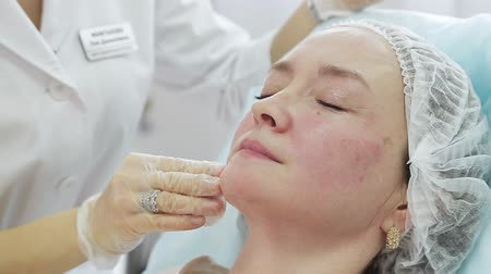 botulinum : Face skin lifting injections. Beautician making botox injections. glabellar frown line care. Female face rejuvenation