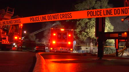 night scene : Police tape and flashing lights of fire engines at night emergency, Utah.