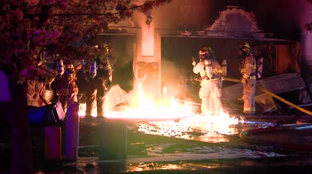 dom : Several fire fighters extinguish flames at house fire, Utah.