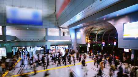 lapse : Passengers pass through Shinagawa Station in Tokyo, Japan Stock Footage