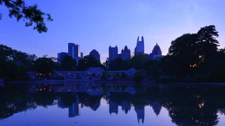ga : Atlanta, Georgia, USA time lapse skyline at Piedmont Park.