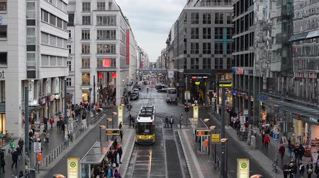 berlin skyline : BERLIN, GERMANY - SEPTEMBER 16, 2013: Pedestrians and traffic move along Friedrichstrasse. Though once bisected by the Berlin Wall, the area has been rejuvenated commercially since the early 1990s.