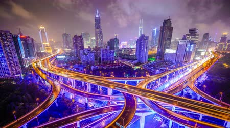 Shanghai, China highways and city at night.