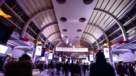 walkthrough : TOKYO - FEBRUARY 6, 2013: POV Crowds pass through Shinagawa Station. It is a major railway station in Tokyo.