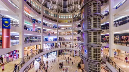 határkő : 00:01 | 00:10 1×  KUALA LUMPUR, MALAYSIA - SEPTEMBER 15, 2015: Shoppers in Suria KLCC Mall. The mall is one of several shopping complexes within the Kuala Lumpur City Centre multipurpose development area. Stock mozgókép