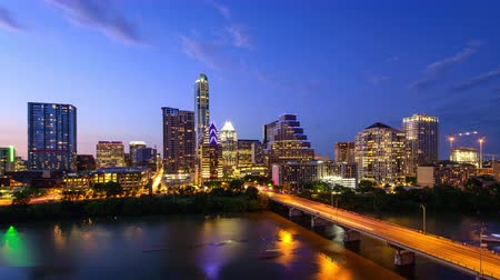 Austin, Texas, USA downtown skyline time lapse on the Colorado River.