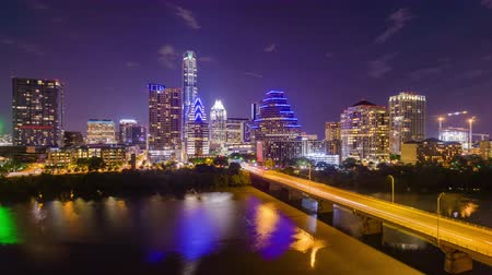 night scene : Austin, Texas, USA downtown skyline time lapse on the Colorado River.