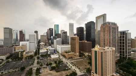 Houston, Texas, USA day to night skyline with stormy skies.