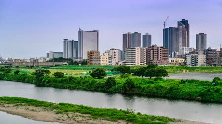 kanto district : Kawasaki, Japan skyline time lapse on the Tamagawa River.