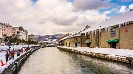 OTARU, JAPAN - FEBRUARY 7, 2017: Crowds flock to the historic canal of Otaru during the annual snow festival.