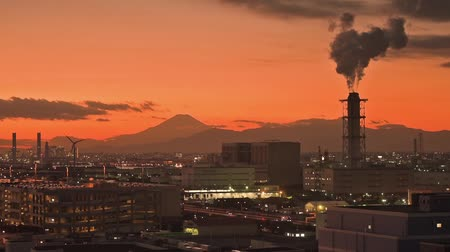 Mt. Fuji and factories viewed from Kawasaki, Japan.