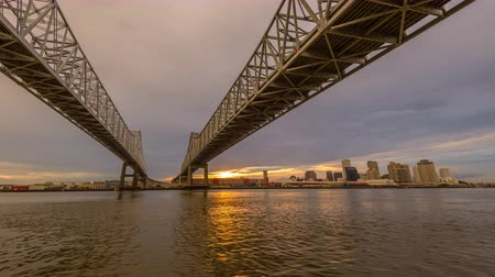 New Orleans, Louisiana, USA at Crescent City Connection Bridge over the Mississippi River during sunset. Wideo