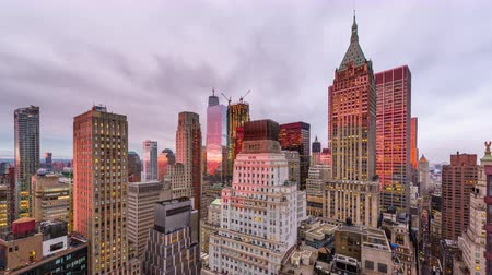 New York City financial district cityscape at twilight.