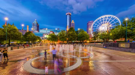 ga : ATLANTA, GEORGIA - AUGUST 21, 2016: Visitors play in Centennial Olympic Parks landmark fountains. The Park was built for the 1996 Summer Olympics and remains a popular destination.