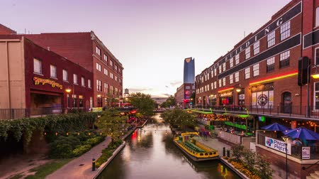 OKLAHOMA CITY, OKLAHOMA - SEPTEMBER 1, 2018: Visitors enjoy the Bricktown River Walk in downtown Oklahoma City. This historic and once abandoned district has been revitalized since the late 90s.