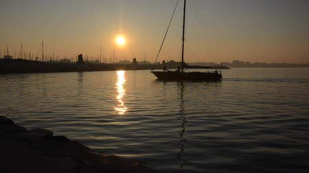 furl : Sailboat back at sunset