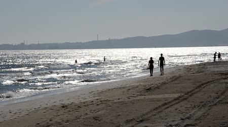 People enjoying the sea in the summertime