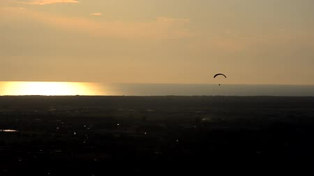 Paragliding practice at the sunset