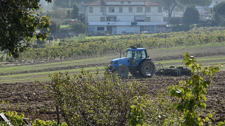 furrow : View of tractor preparing the soil for sowing