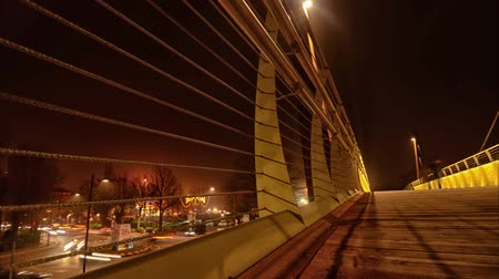 Pedestrian bridge and traffic in time-lapse