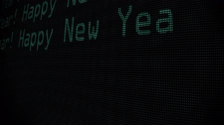 pozdrav : hand typing happy new year words writing on green old led lcd tube computer display screen close up pixel 3d animation - new quality retro vintage futuristic wording typography video footage loop Dostupné videozáznamy