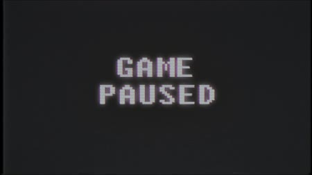 универсальный : retro videogame GAME PAUSED text on computer old tv glitch interference noise screen animation seamless loop New quality universal vintage motion dynamic animated background colorful joyful video