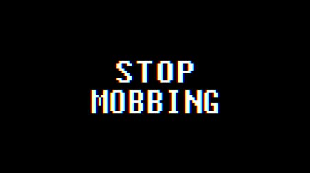 mobbing : retro videogame STOP MOBBING word text computer old tv glitch interference noise screen animation seamless loop New quality universal vintage motion dynamic animated background colorful joyful video
