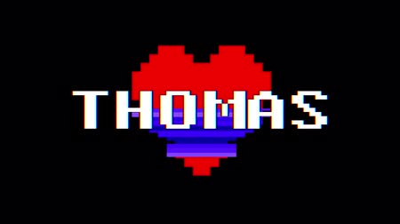 distorsiyon : pixel heart THOMAS word text glitch interference screen seamless loop animation background new dynamic retro vintage joyful colorful video footage Stok Video