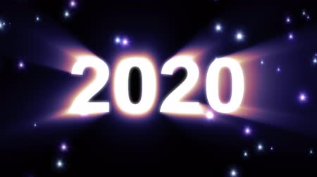 speciális : 2020 text in light big bang explosion rainbow colors shiny animation loop on black background new quality cool nice motion joyful holiday video footage loop design